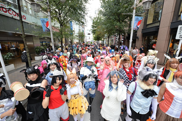 Crowd of Japanese People Celebrating Halloween at a Street Party